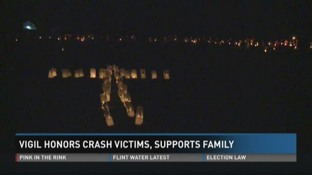 Vigil honors crash victims, supports family