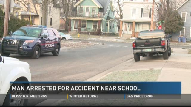 Man arrested for accident near Grand Rapids school