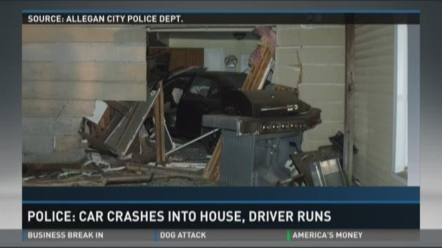 Police: Car crashes into house, driver runs